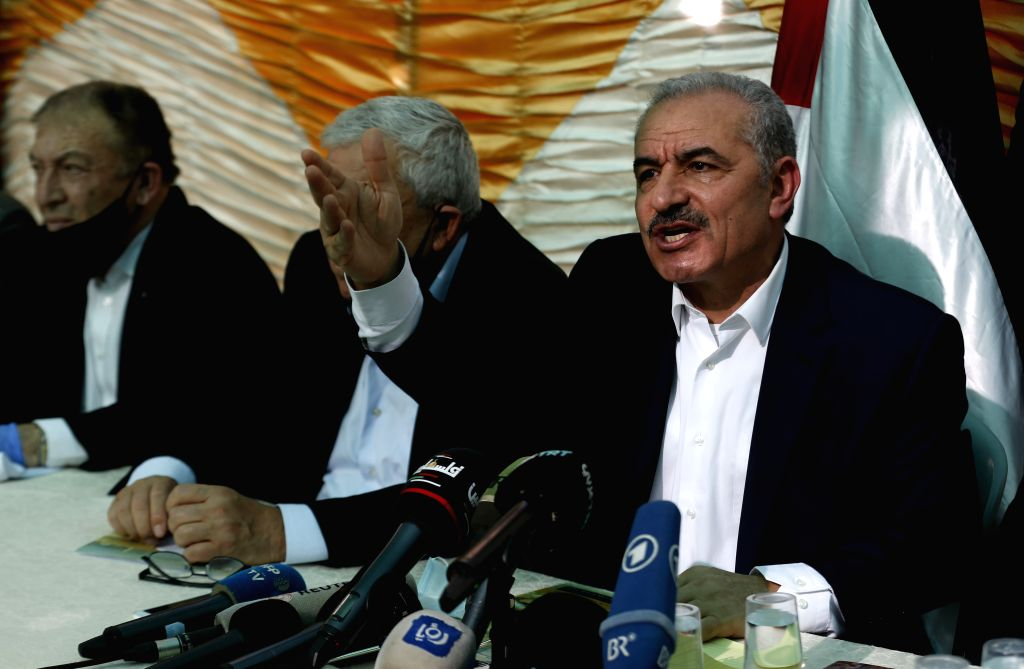 Palestinian Prime Minister Mohammed Ishtaye (R) speaks during a meeting in Fasayil village in the Jordan Valley, on June 24, 2020. The Palestinian government, ... - Mohammed Ishtaye
