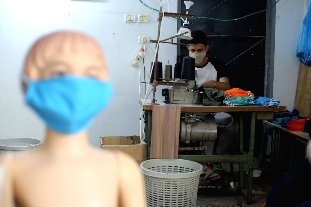 Palestinian tailor Bilal Al-Zomor makes face masks at his workshop in the southern Gaza Strip city of Rafah, on Aug. 30, 2020. Palestine on Sunday recorded 536 new ...