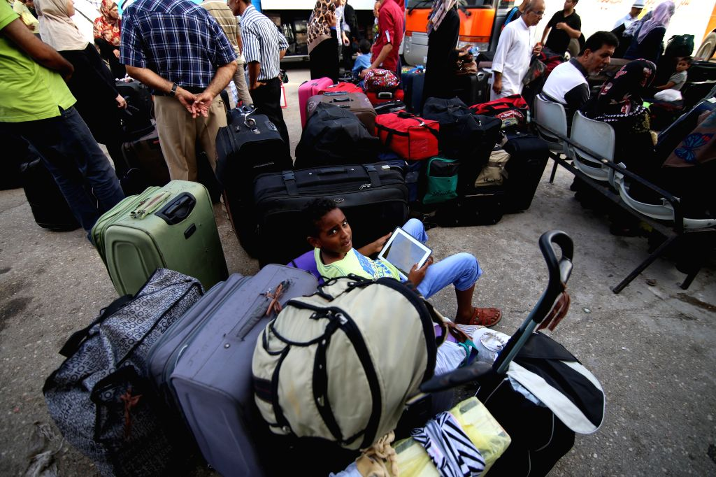 Palestiniana wait for travel permit to cross into Egypt at the Rafah border crossing between Egypt and the southern Gaza Strip Aug. 18, 2015. Egypt on Monday reopened ...
