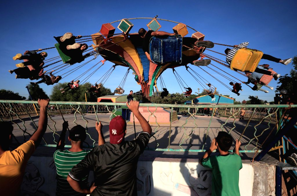 Palestinians enjoy their time during the holiday of Eid al-Adha in Khan Younis, southern Gaza Strip, on Aug. 2, 2020.