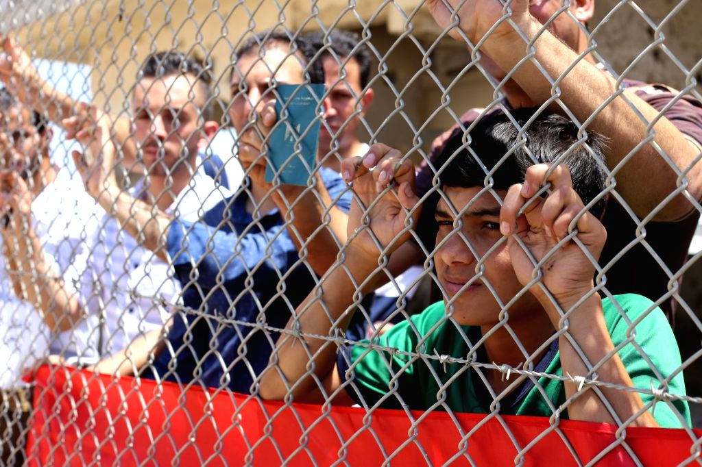 Palestinians stage a demonstration at Rafah crossing point between southern Gaza Strip and Egypt calling on the Egyptian Authorities to reopen the closed crossing for patients who need medical ...