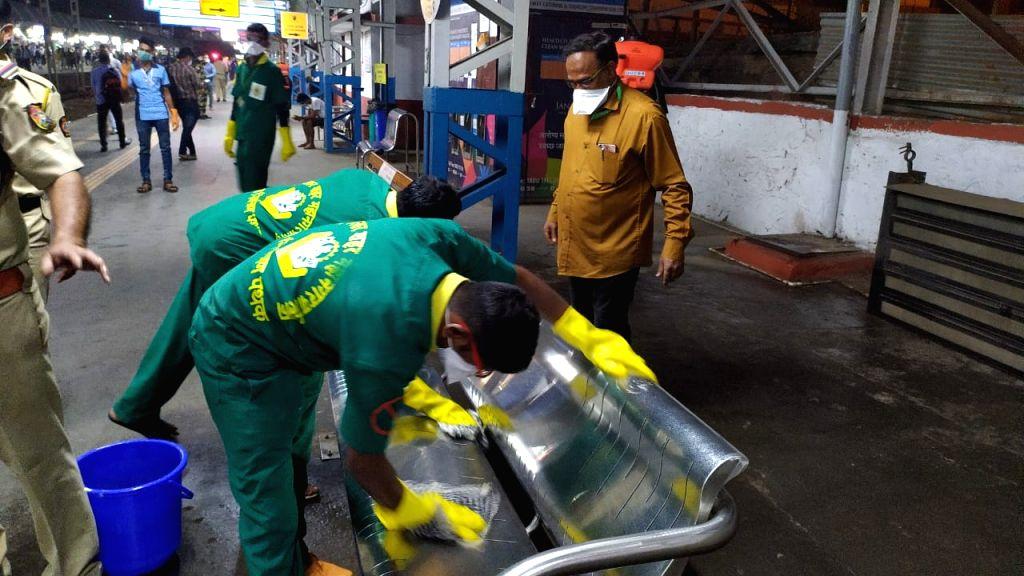 Palghar (Maharashtra):  Bahujan Vikas Aghadi initiates proper Fumigation at Vasai-Virar and other stations amid coronavirus pandemic, in Maharashtra's Palghar on 19 March 2020. (Photo: IANS)