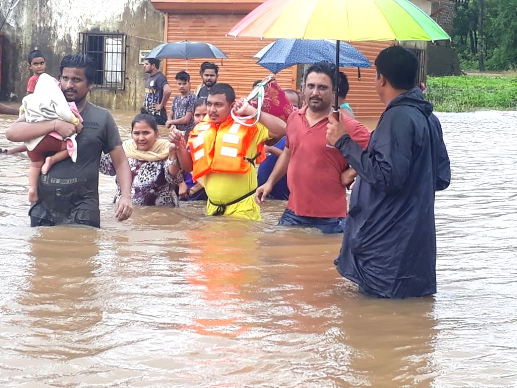 Palghar: NDRF personnel rescue villagers in Palghar, Maharashtra on Aug 4, 2019. (Photo: IANS)