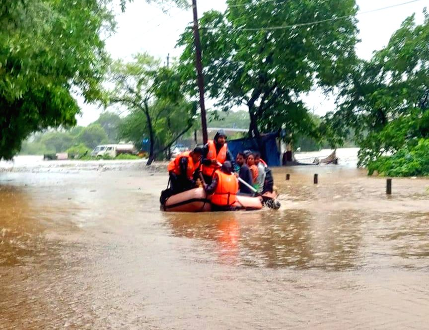Palghar: NDRF personnel rescue villagers in Palghar's Chandip and Bhoida localities, Maharashtra on Aug 4, 2019. (Photo: IANS)