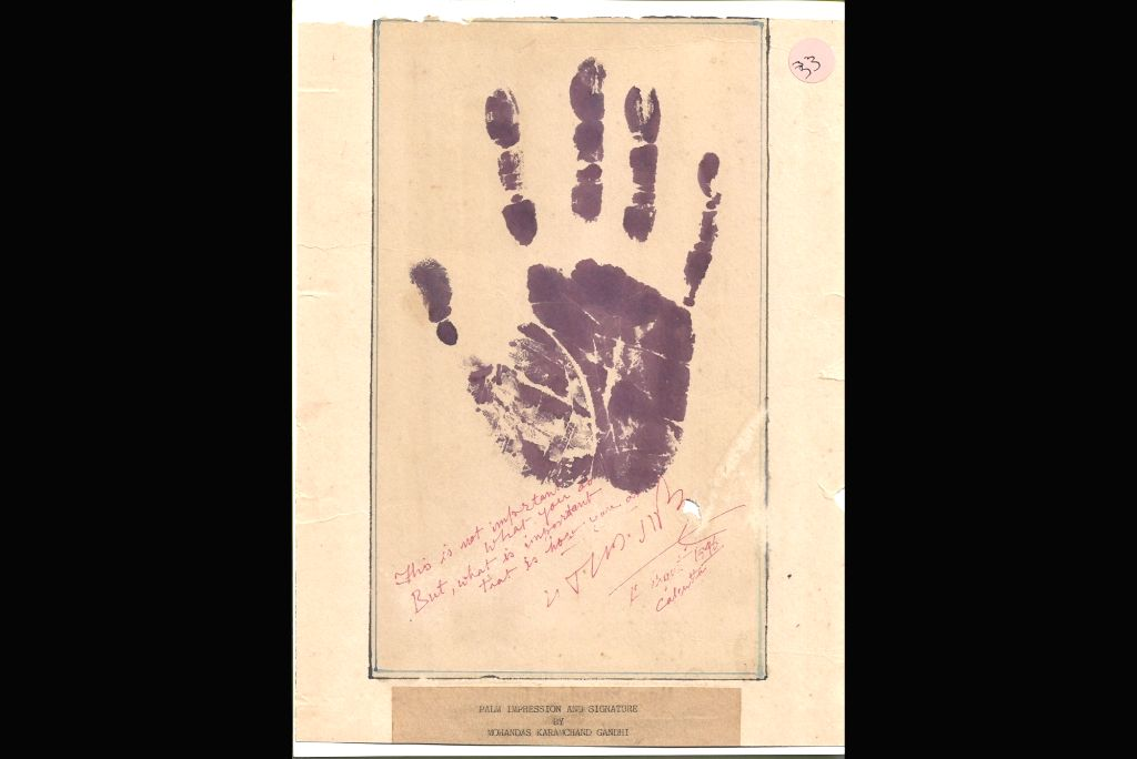 Palm impression and signature of Mahatma Gandhi.