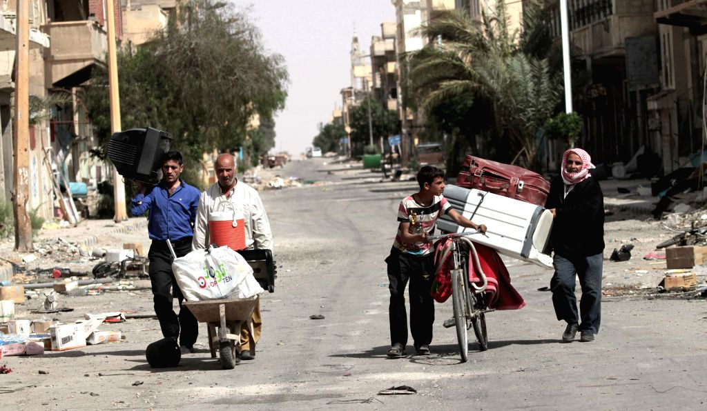 PALMYRA, April 12, 2016 - Syrian civilians transport belongings out of their houses in Palmyra, central Syria, on April 11, 2016. Hundreds of civilians were transported on Saturday to the ancient ...