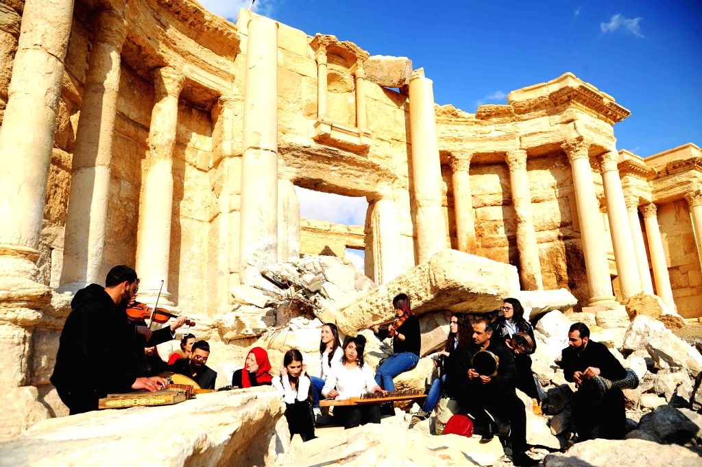 PALMYRA, March 5, 2017 - A musical band plays amid the rubble of the ruined Roman Theater in the ancient city of Palmyra, central Syria, on March 4, 2017. The Syrian army announced in a statement ...