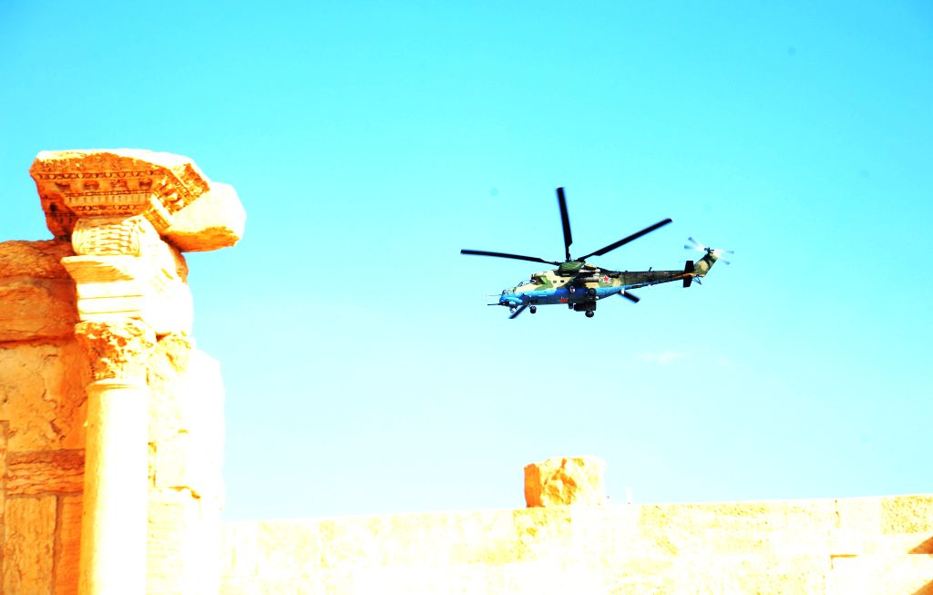 PALMYRA, March 5, 2017 - A Russian helicopter hovers over the ancient city of Palmyra, central Syria, on March 4, 2017. The Syrian army announced in a statement that the Syrian forces captured the ...