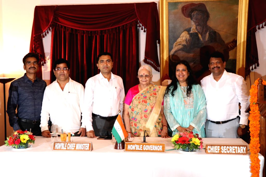 Panaji: Goa Governor Mridula Sinha and Chief Minister Pramod Sawant with the newly sworn in Cabinet Ministers - Congress rebels Chandrakant Kavlekar, Jennifer Monserrate, Filipe Nery Rodrigues and lone BJP MLA Michael Lobo, who resigned as Deputy Spe - Pramod Sawant and Mridula Sinha