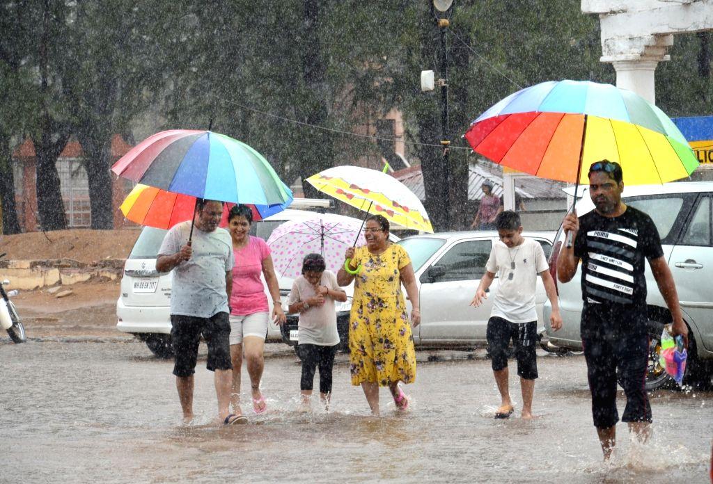 Panaji: People enjoy rains in Panaji on June 20, 2019. (Photo: IANS)