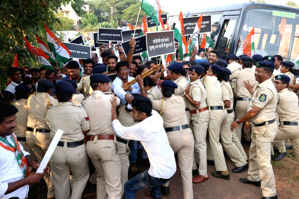 Panaji: Policemen prevent Congress workers staging a protest outside Central Bureau of Investigation (CBI) office against the central government's move to strip CBI Director Alok Verma of his power from entering the bureau's premises, in Panaji, on O - Alok Verma