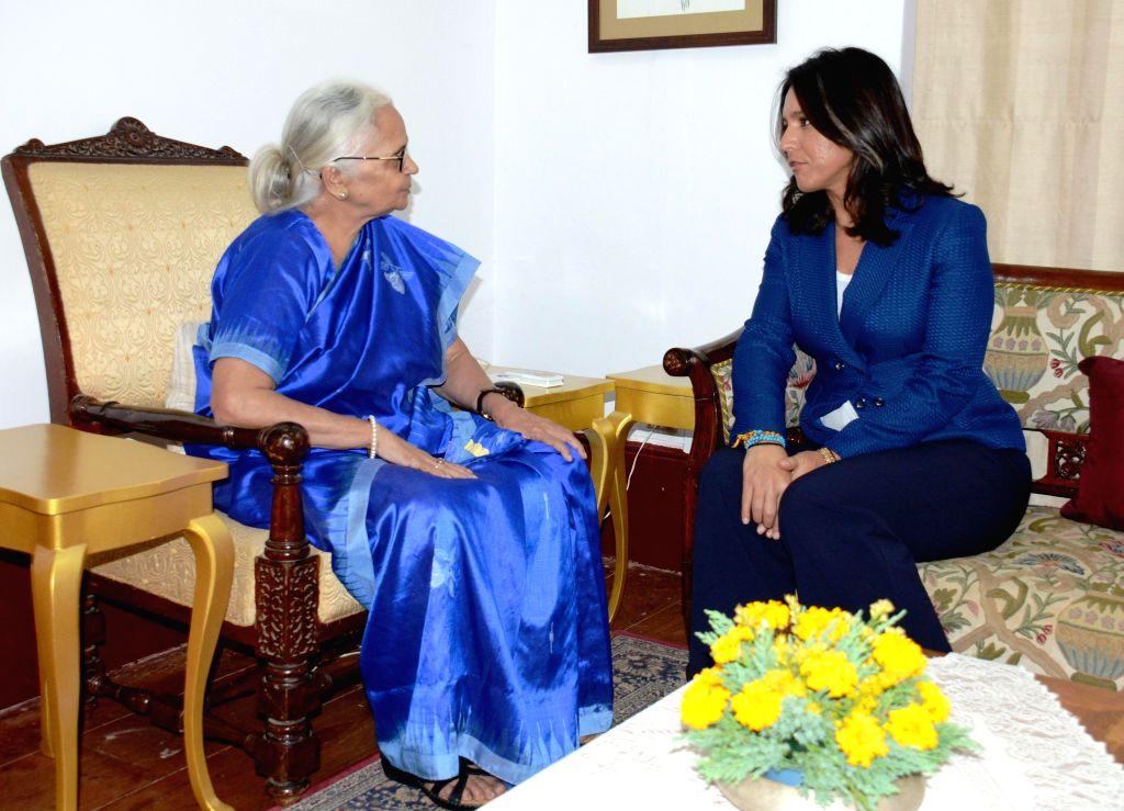 The Member of the US House of Representatives Tulsi Gabbard calls on Goa Governor Mridula Sinha at Raj Bhawan in Panaji, on Dec 20, 2014. - Mridula Sinha