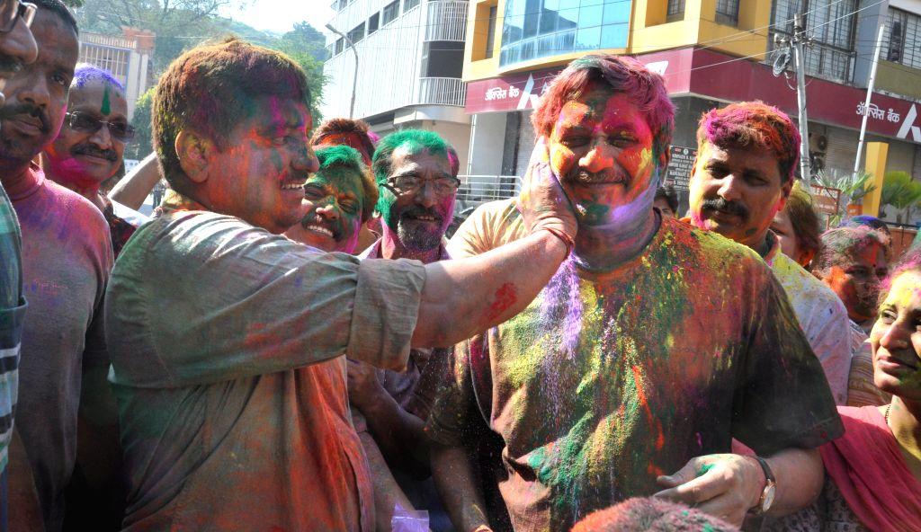 Union Defence Minister Manohar Parrikar celebrates Holi in Panaji on March 6, 2015.