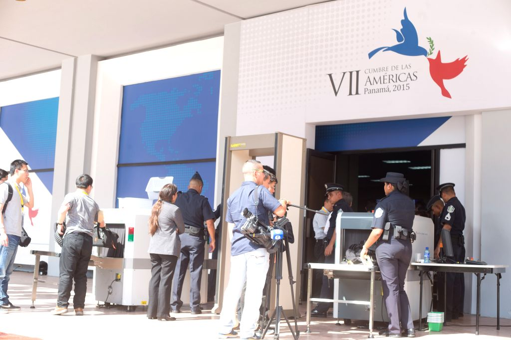 Reporters wait to enter the venue for the Seventh Summit of the Americas in Panama City, capital of Panama, April 9, 2015. The Seventh Summit of the Americas ...