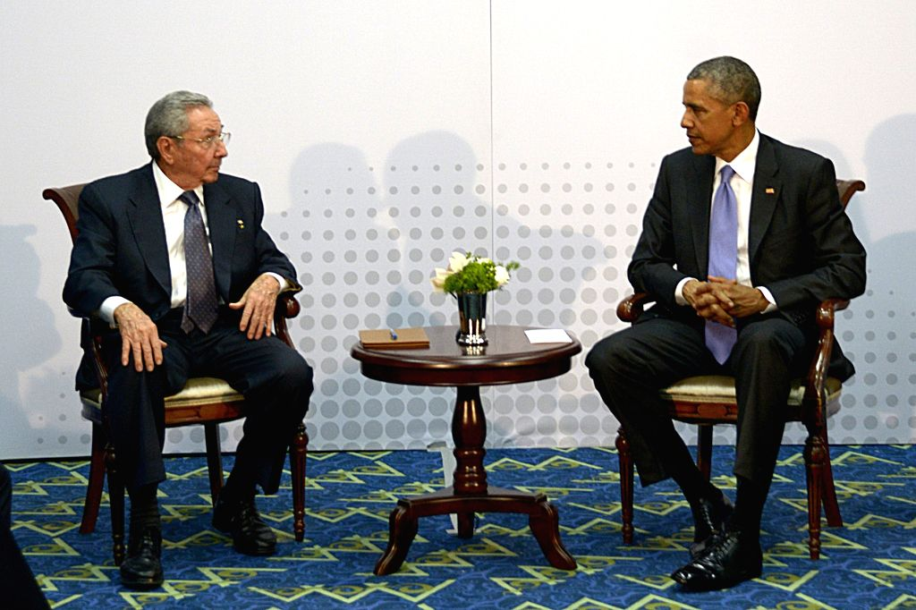 Cuban leader Raul Castro (L) meets with U.S. President Barack Obama (R) on the sidelines of the 7th Summit of the Americas in Panama City, capital of Panama, ...