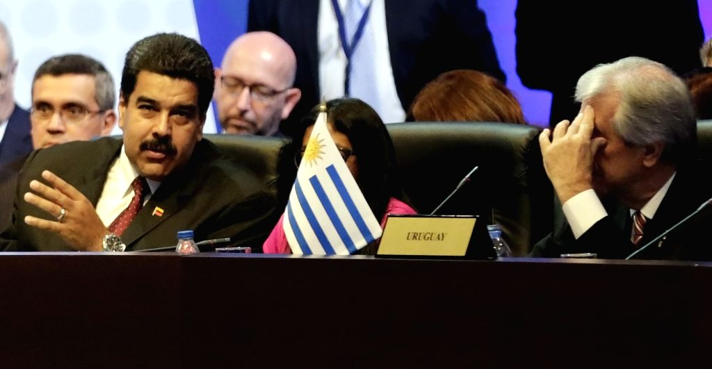 Venezuela's President Nicolas Maduro (L) takes part in the Plenary Session of the 7th Summit of the Americas in Panama City, capital of Panama, on April 11, ...