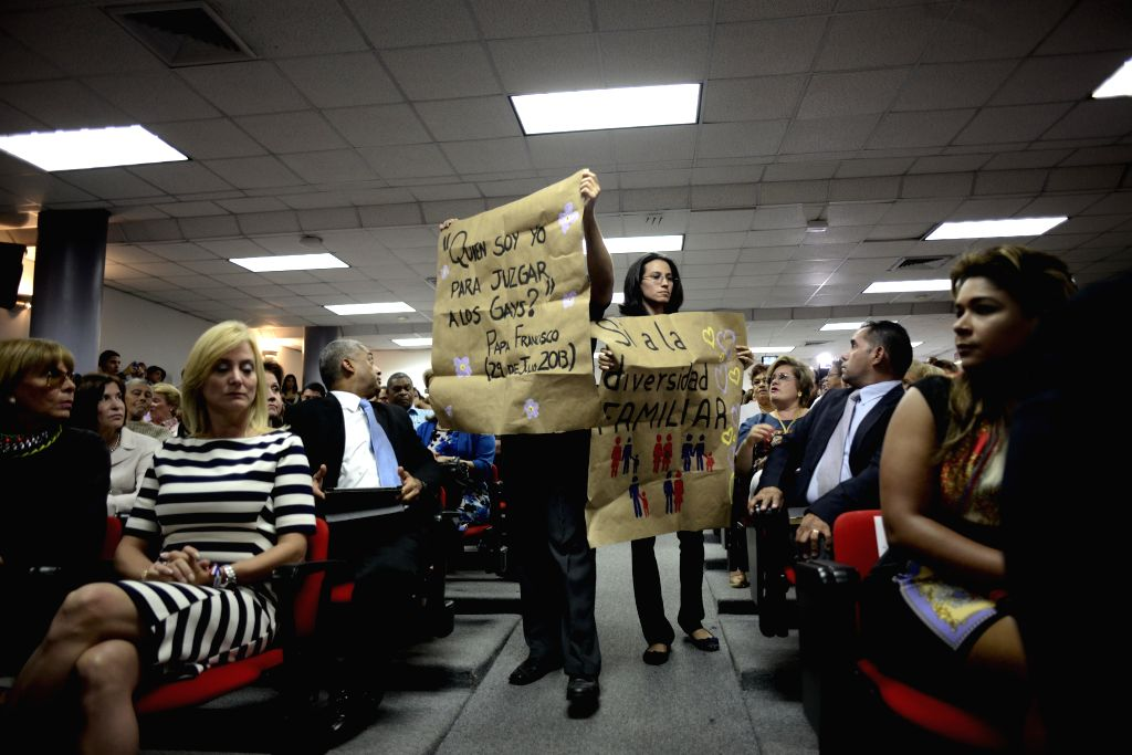 """Activists hold banners requiring for the equal rights for the homosexual families during the signature of the """"National Compromise for the Life and the ..."""