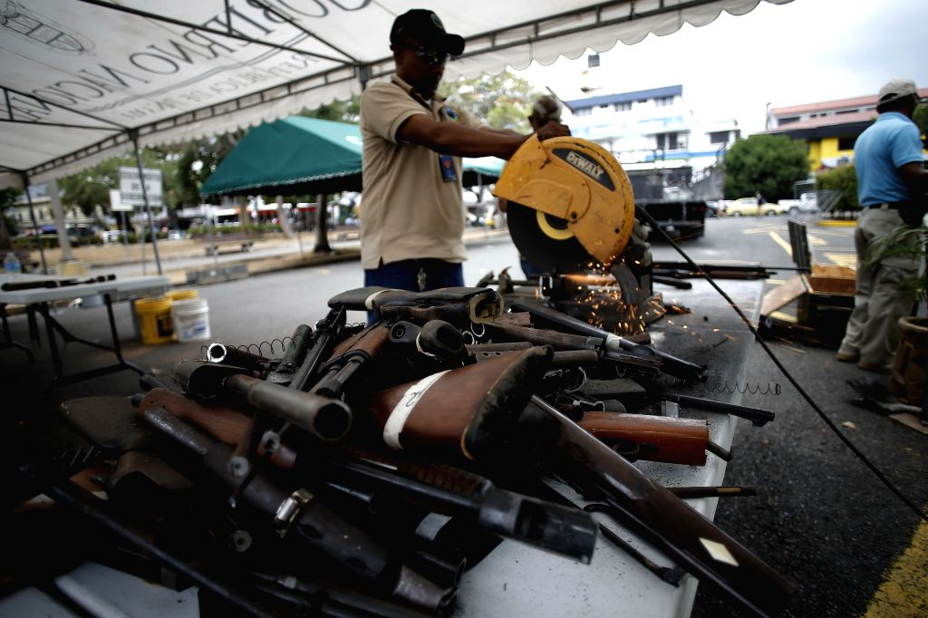 A member of the National Police destroys a firearm, in Panama City, capital of Panama, on April 24, 2014. The National Police destroyed over 394 firearms ...