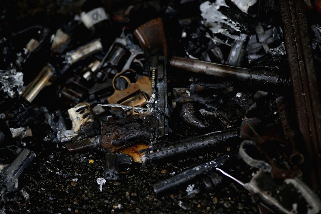 Weapons are destroyed by members of the National Police, in Panama City, capital of Panama, on April 24, 2014. The National Police destroyed over 394 firearms .