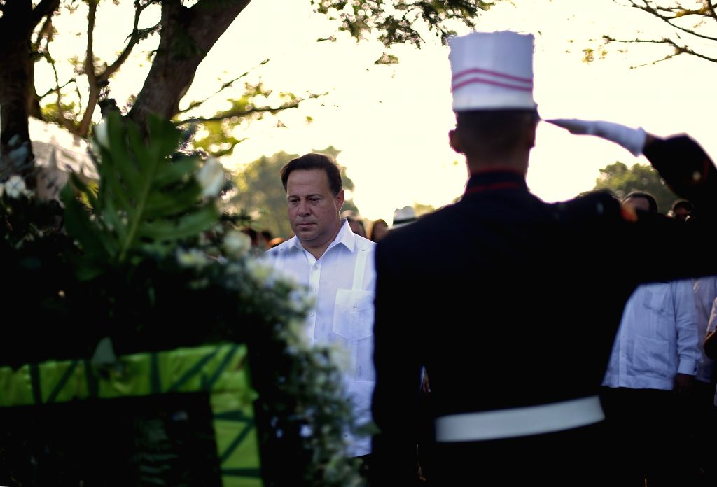 Panama's President Juan Carlos Varela (L) participates in a ceremony held in honor to the death during the United States invasion of Panama on Dec. 20, 1989, in