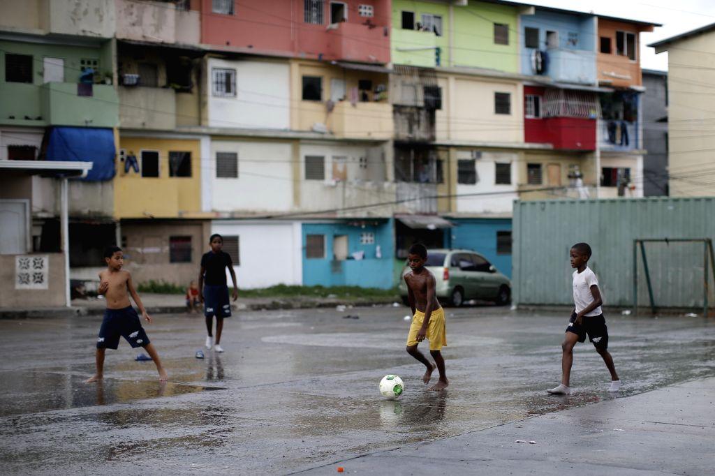 "Children play soccer at ""La Porqueriza"" neighborhood, in Panama City, capital of Panama, on May 14, 2014."
