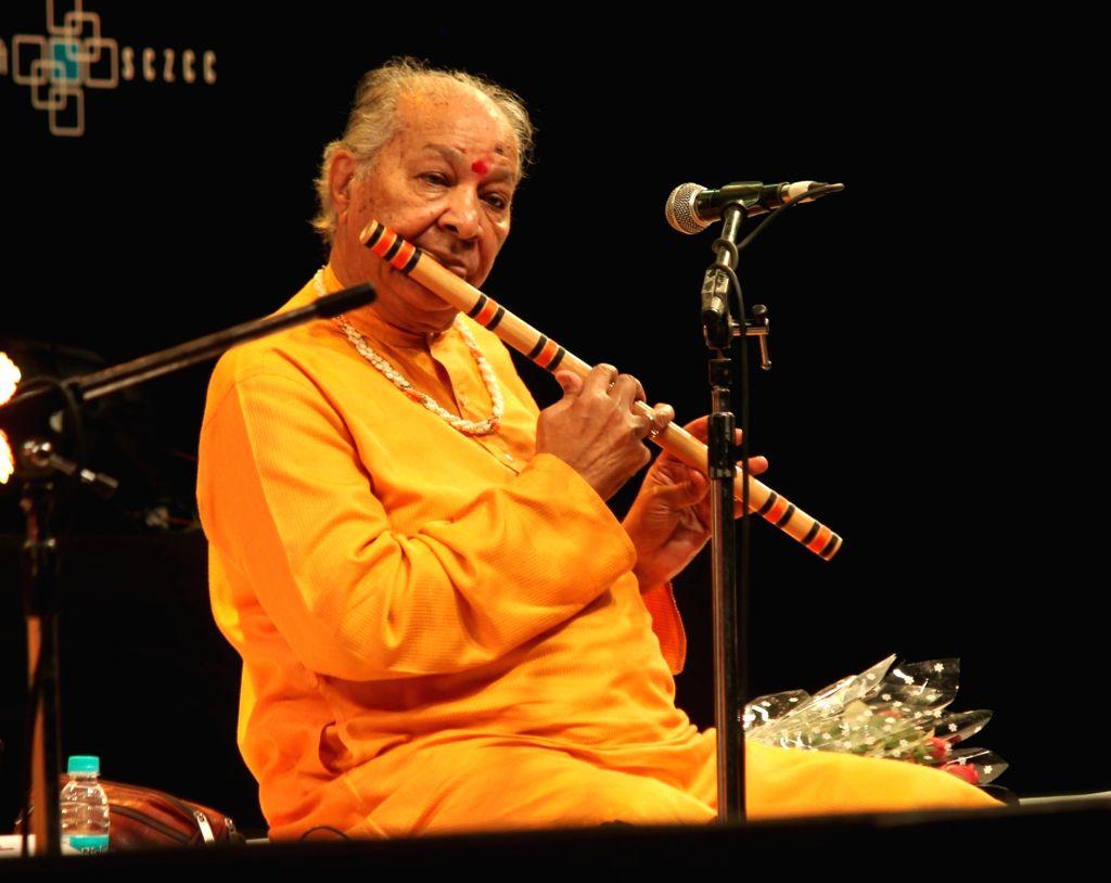 Pandit Hariprasad Chaurasia performs during  Dr. Vasantrao Deshpande International  Sangeet Samaroh - silver jubilee celebrations in Nagpur on July 31, 2016.