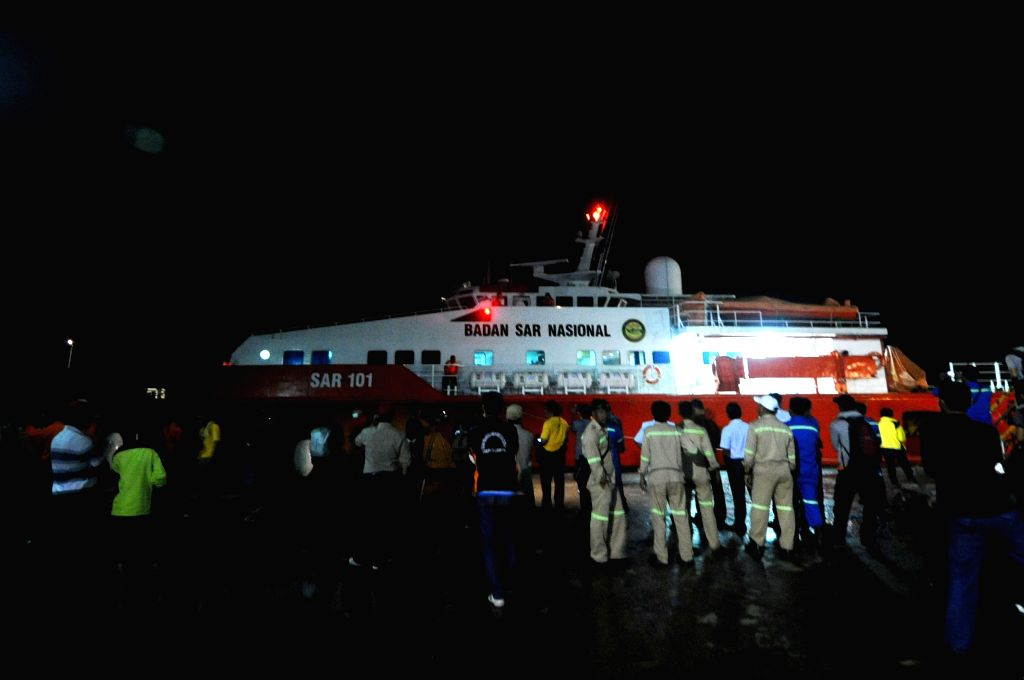 Members of Indonesian Search and Rescue Agency (Basarnas) wait for searching ship in Pangkalan Bun, Central Kalimantan, Indonesia, Dec. 31, 2014. After ...