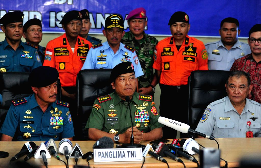 Indonesian Armed Forces Chief Gen. Moeldoko (C Front) attends a press conference following the tail of crashed AirAsia QZ8501 plane lifted from sea at ...