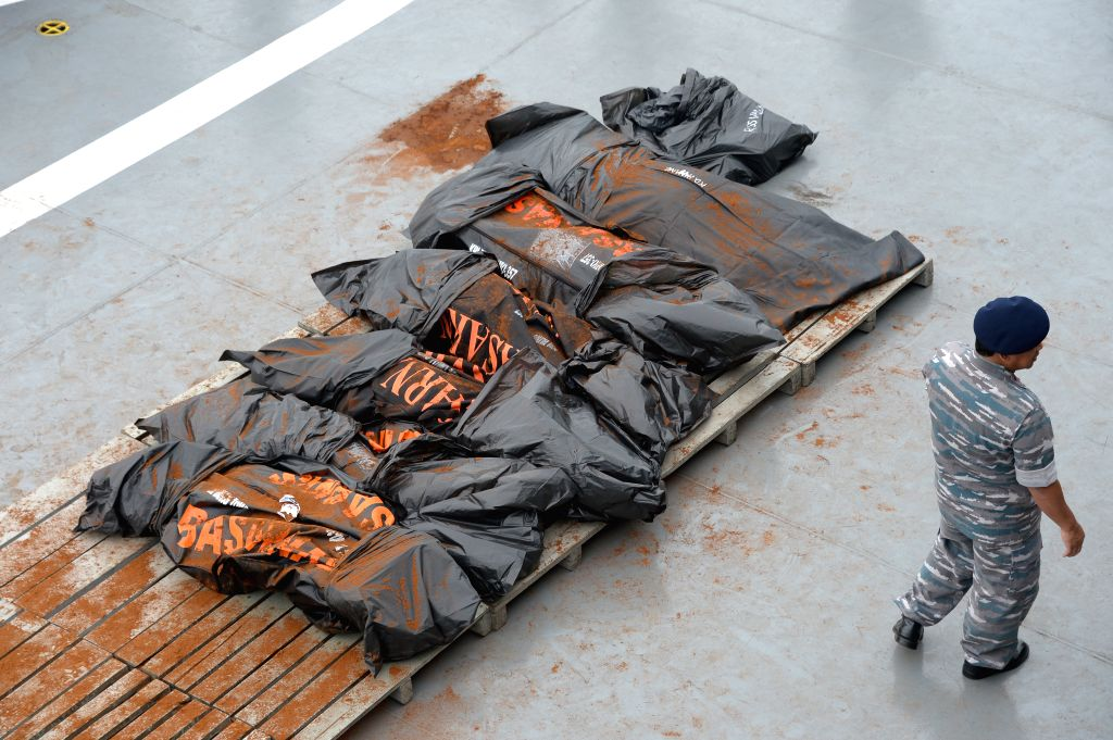 Dead bodies in body bags of victims of AirAsia flight QZ8501 lie down at Indonesian navy vessel KRI Banda Aceh in Indonesia, Jan. 3, 2015. ...