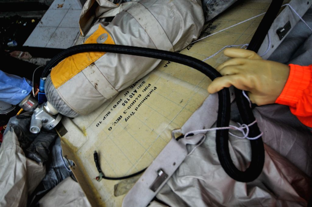 Photo taken on Jan. 4, 2015 shows recovered debris of the AirAsia flight QZ8501 carried by a Singapore Navy helicopter at Iskandar Air Base, Pangkalan Bun, ...