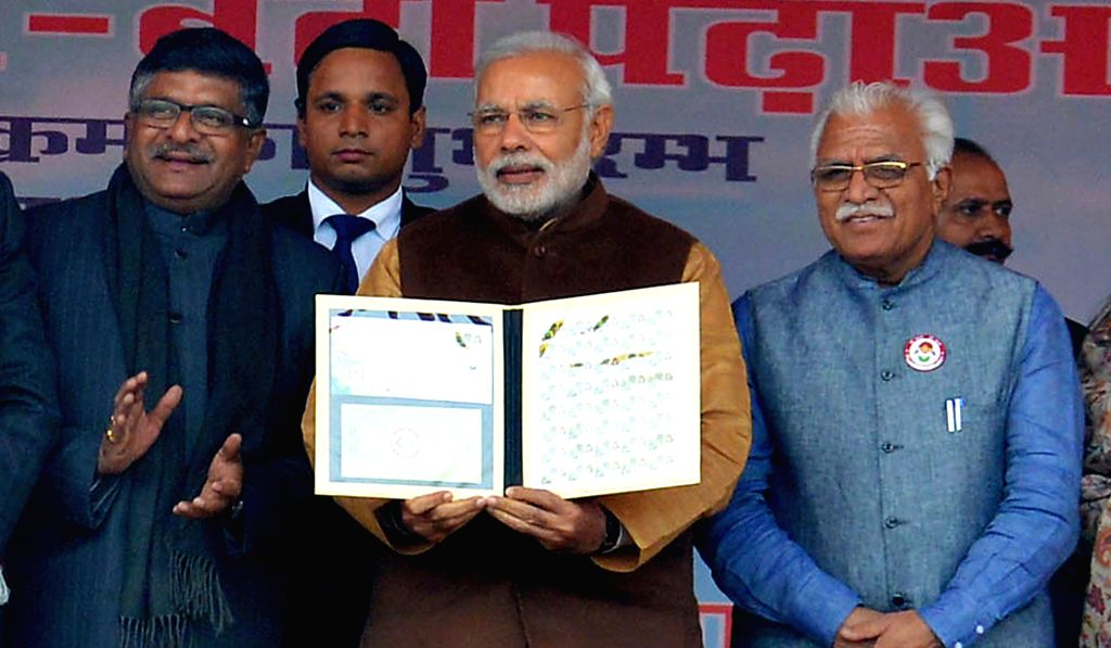 Prime Minister Narendra Modi  at the launch of `Beti Bachao-Beti Padhao` campaign in Panipat, Haryana on Jan 22, 2015. Also seen Haryana Chief Minister Manohar Lal Khattar and Union Minister - Narendra Modi and Manohar Lal Khattar