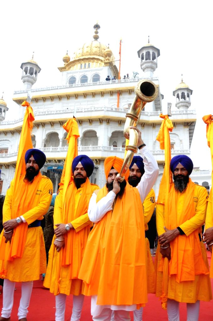 Panj Pyaras lead the 'Nagar Kirtan' procession near Golden Temple organised on the eve of the 338th birth anniversary of Sikh warrior Shaheed Baba Deep Singh in Amritsar on Jan 25, 2020. - Baba Deep Singh