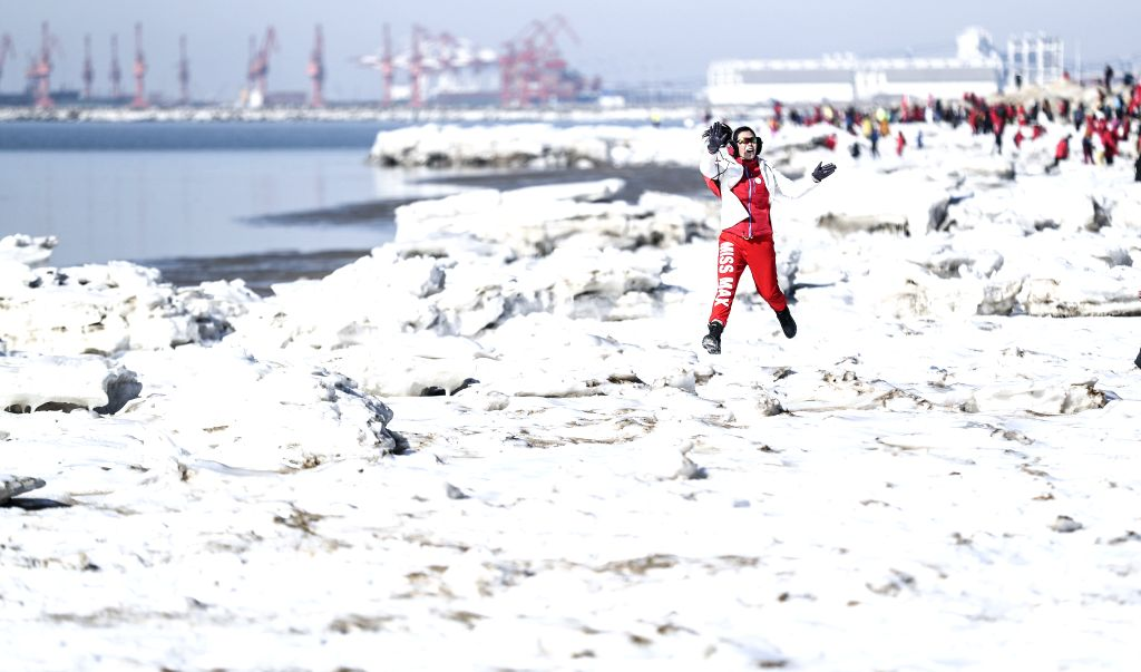 PANJIN, Jan. 26, 2019 - A participant poses on the ice-covered trekking route during an ice trekking event in Panjin, northeast China's Liaoning Province, on Jan. 26, 2019.