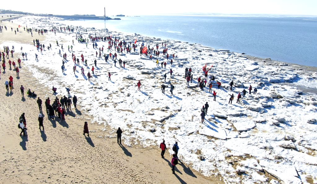 PANJIN, Jan. 26, 2019 - Photo taken with an UAV drone shows participants walk on the ice-covered trekking route during an ice trekking event in Panjin, northeast China's Liaoning Province, on Jan. ...