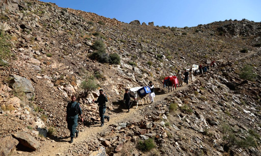 PANJSHIR, Sept. 28, 2019 - People transport election materials for the upcoming presidential election in Shutul District of Panjshir Province, east Afghanistan, Sept. 27, 2019. Afghanistan held ...