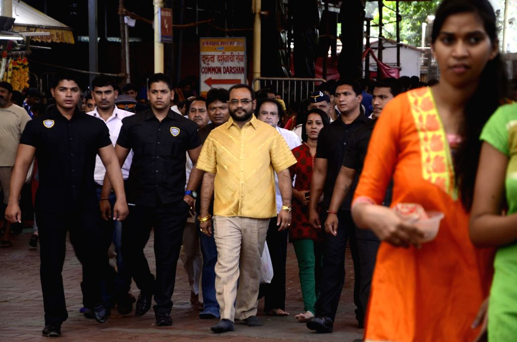 Pankaj Parakh, a Nashik based businessman wearing a shirt made-up of 4 kg pure gold costing Rs 1 .30 crore during his visit to Siddhivinayak Temple in Mumbai on Aug 5, 2014.