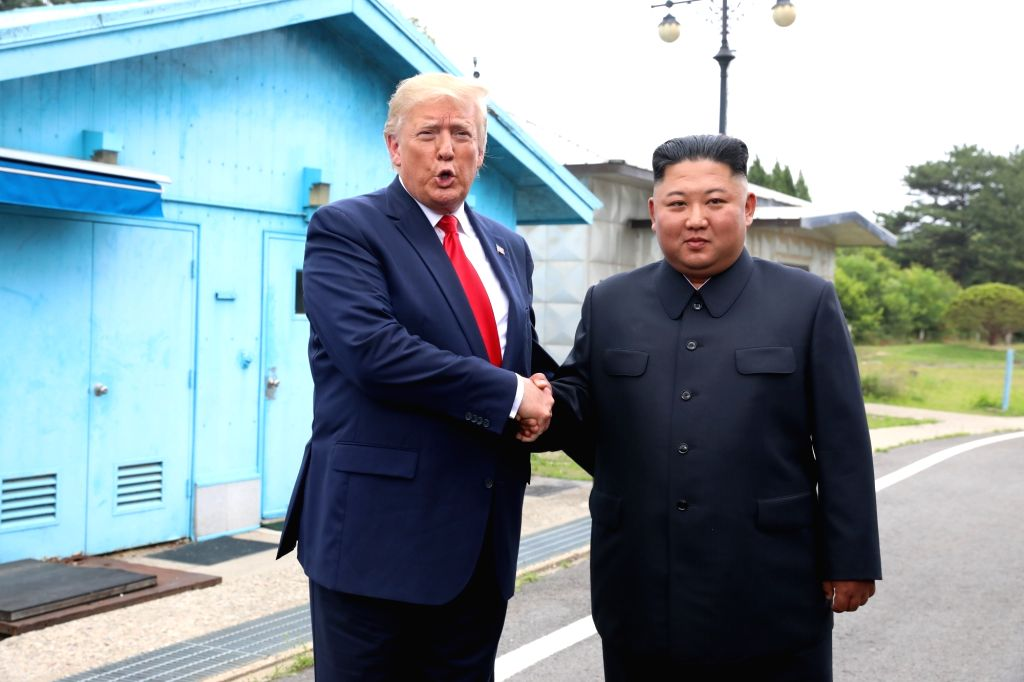 Panmunjom, June 30, 2019  U.S. President Donald Trump meets with Kim Jong Un, top leader of the Democratic People's Republic of Korea (DPRK), in the inter-Korean border village of Panmunjom on June 30, 2019. (Xinhua/NEWSIS/IANS)