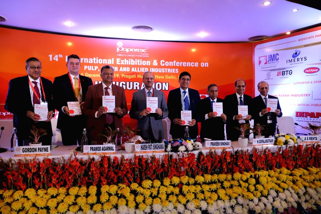 Paper directory being released by JK Paper MD Harsh Pati Singhania accompanied by other dignitaries, releases Paperex Event Book during 14th International Technical Conference and ...