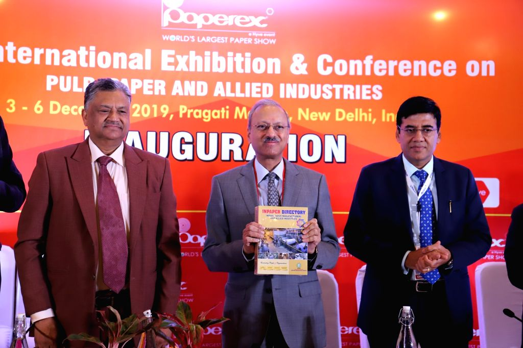 Paper directory being released by JK Paper MD Harsh Pati Singhania flanked by Indian Agro & Recycled Paper Mills Association (IARPMA) President Pramod Agarwal and Asia Pacific ...