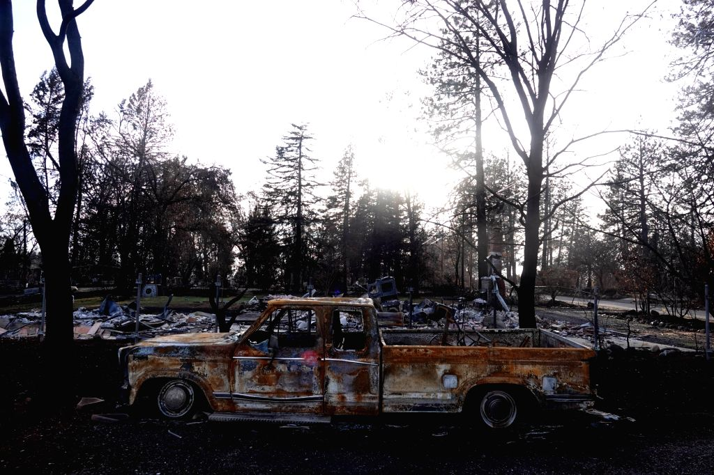 PARADISE, Dec. 8, 2018 - A destroyed car is seen in the site where the wildfire engulfed in Paradise of Butte County, California, the United States on Dec. 7, 2018.