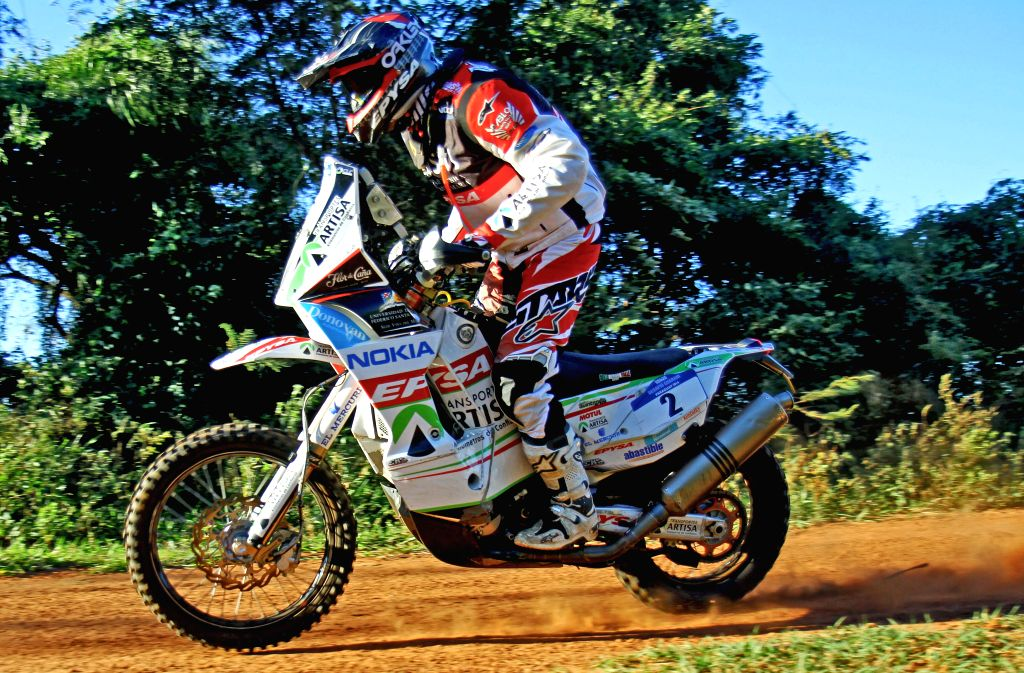 Chilean pilot Pablo Quitanilla, of the USMRaid Rally Team, takes part in the fist leg of the Guarani Challenge of the Dakar Series, in the Paraguari department, ..