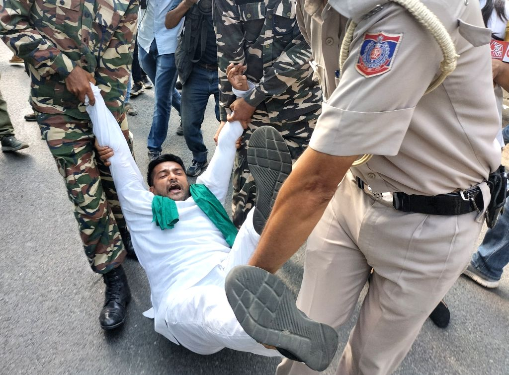 Paramilitary force personnel detain a Youth Congress activist  protesting against Sunday's killing of four farmers in Uttar Pradesh Lakhimpur Kheri in New Delhi on Monday October 04 , 2021