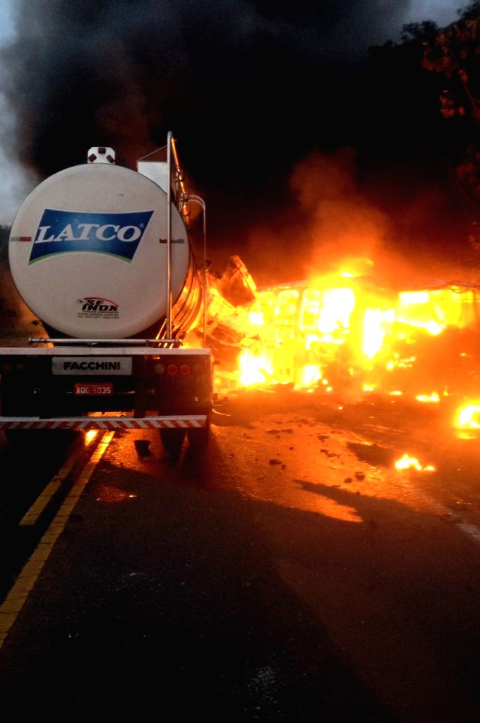 PARANA, Oct. 31, 2016 - Image provided by Ipora's Road Police shows a bus and a truck on fire at the site of a major road accident on a highway in the state of Parana, Brazil, on Oct. 31, 2016. At ...