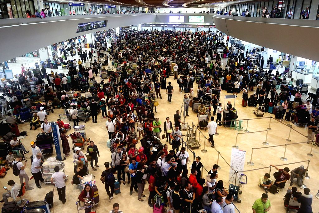 PARANAQUE CITY, Aug. 18, 2018 (Xinhua) -- A crowd of stranded passengers wait for resumption of their flights at the Ninoy Aquino International Airport (NAIA) in Paranaque City, the Philippines, Aug. 18, 2018. Philippine airport authorities reopened