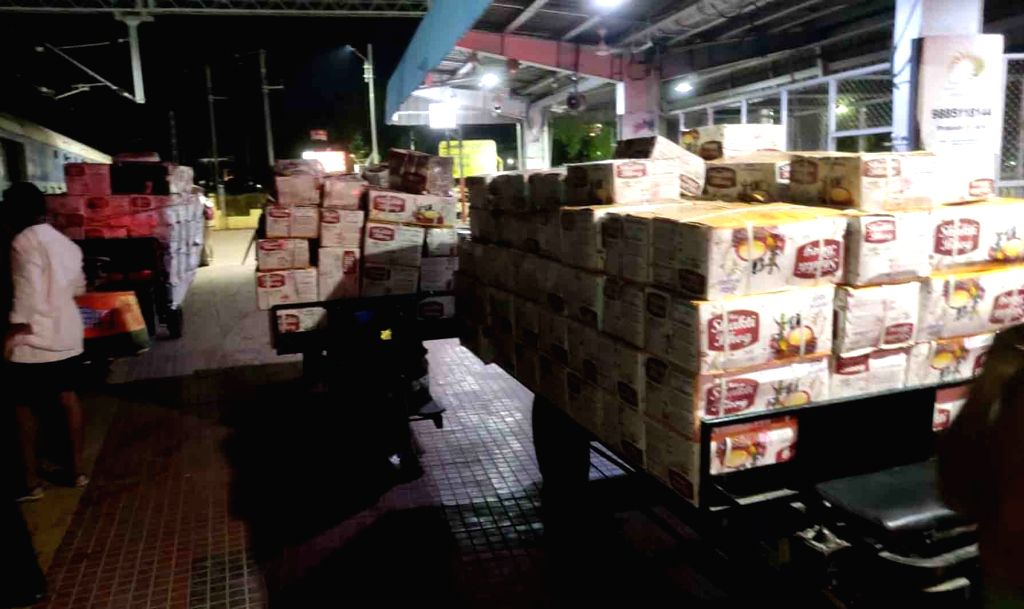 Parcels contaning essential commodities being offloaded a Special Parcel Express train at the Vijayawada Railway Station during the extended nationwide lockdown imposed to mitigate the ...
