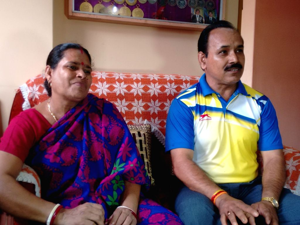 Parents of Dipa Karmakar who has created history by becoming the first Indian woman gymnast to qualify for Olympics in Agartala, on April 18, 2016.