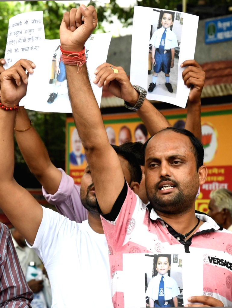 Parents stage a protest over the brutal murder of a seven-year-old student inside the washroom of Ryan International School at Jantar Mantar in New Delhi on Sept 10, 2017.