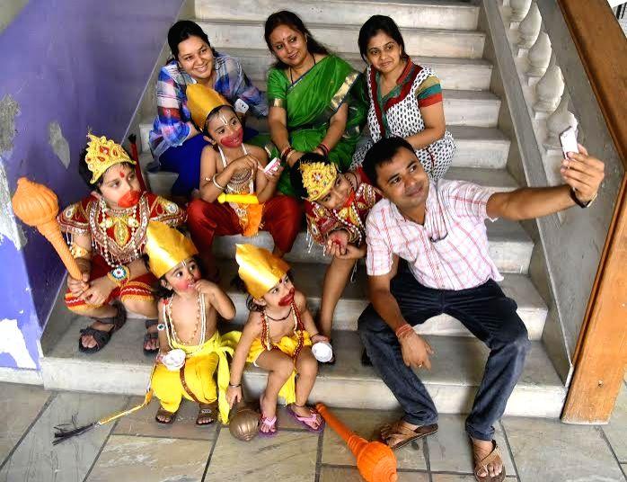 Parents take a selfie with children disguised as  Hanuman on Hanuman Jayanti in Nagpur, on April 21, 2016.