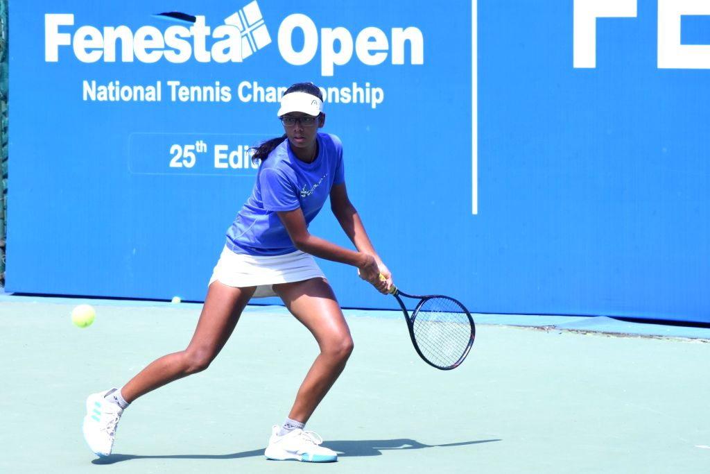 Pari Singh in action against Chahana Budhbatti in Girls U-14 category of the Fenesta Open Junior National Tennis Championship, in New Delhi on Oct 9, 2019. - Pari Singh