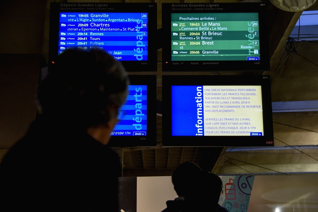 PARIS, April 2, 2018 - Travellers look at information screens at Montparnasse Train Station in Paris, France, on April 2, 2018. The three-month railway strike in France started on Monday.
